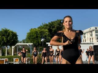Titanic deluxe golf Belek girl dancing near the pool