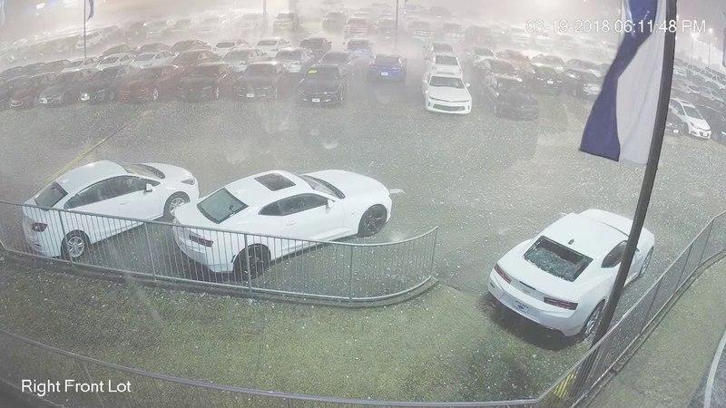 Surveillance video of baseball sized hail damaging new vehicles in Cullman Alabama