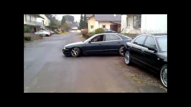 Mazda Millenia lowered on coilovers slammed Xedos 9