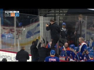 Puck narrowly misses islanders heads, cracks glass instead
