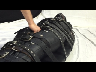 Bound with 20 belts and made to cum in a leather sleepsack