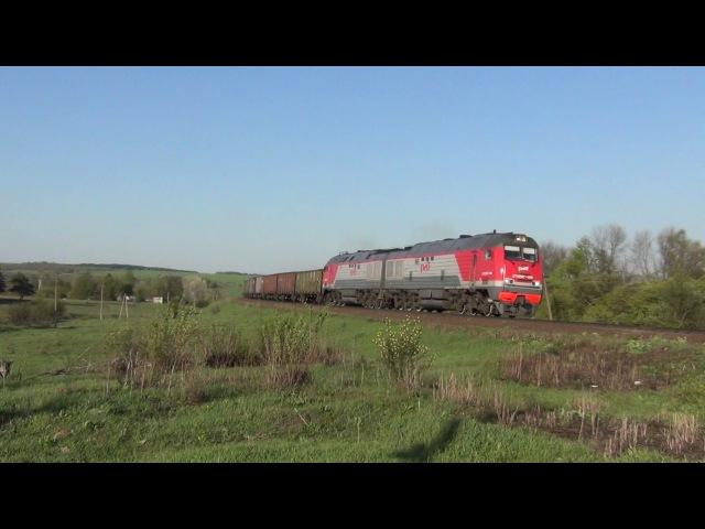 Тепловоз 2ТЭ25МК 0118 с грузовым поездом