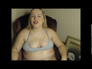 Fat girl with a doughy belly being feed doughnuts